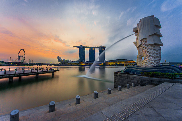 """Rear view of the Merlion statue at Merlion Park, Singapore, with Marina Bay Sands in the distance - 20140307"" by fad3away. - Flickr: http://www.flickr.com/photos/76425142@N07/12948445504/.. Licensed under CC BY 2.0 via Wikimedia Commons."
